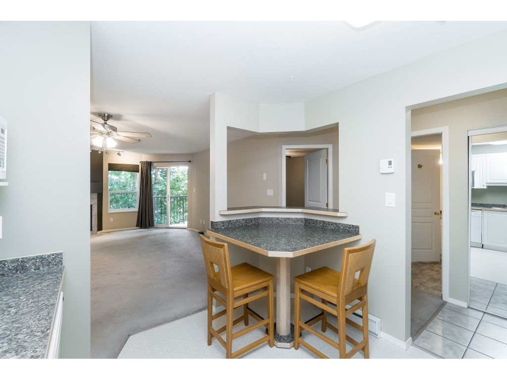 "Photo 7: Photos: 208 33480 GEORGE FERGUSON Way in Abbotsford: Central Abbotsford Condo for sale in ""CARMONDY RIDGE"" : MLS®# R2392370"