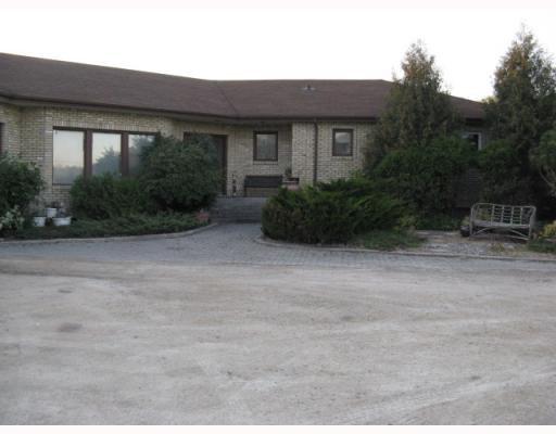 Main Photo: 321 SEEKINGS Street in HEADINGLEY: Headingley South Residential for sale (South Winnipeg)  : MLS®# 2919964