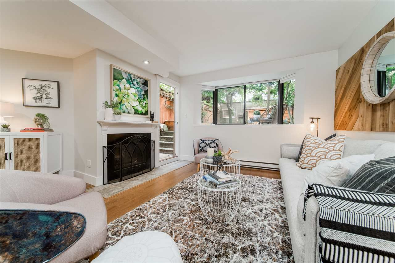 "Main Photo: 104 1922 W 7TH Avenue in Vancouver: Kitsilano Condo for sale in ""MAPLE GARDENS"" (Vancouver West)  : MLS®# R2509137"