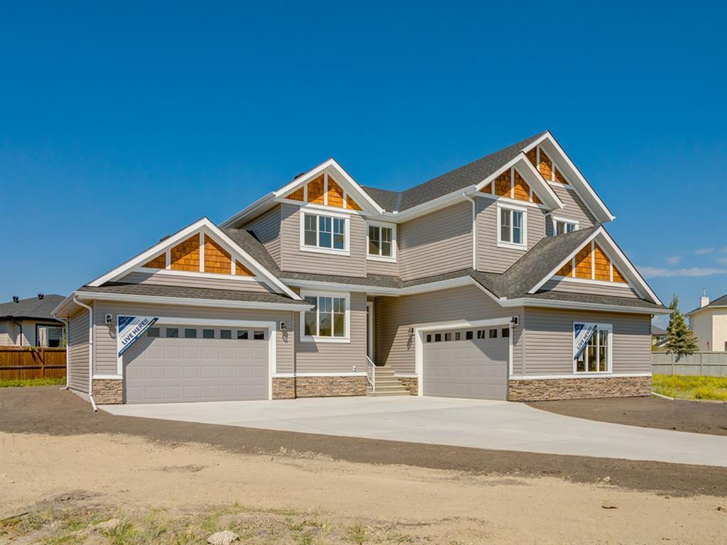 Main Photo: 159 CANOE Crescent SW: Airdrie Detached for sale : MLS®# A1019943
