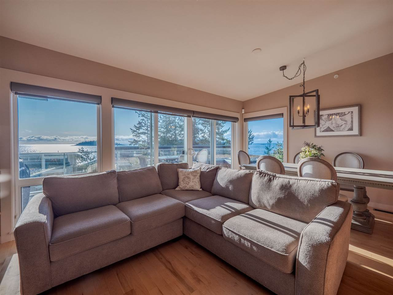 The Living room has spectacular Trail Island ocean views and loaded with natural light