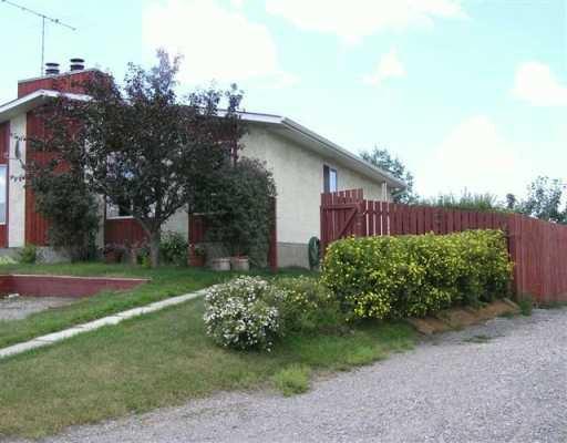 Main Photo: 251 GLENPATRICK Drive: Cochrane Duplex Side By Side for sale : MLS®# C3180503