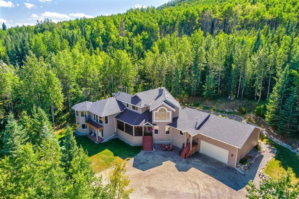 Main Photo: 131 WILD ROSE Close: Bragg Creek Detached for sale : MLS®# A1029603