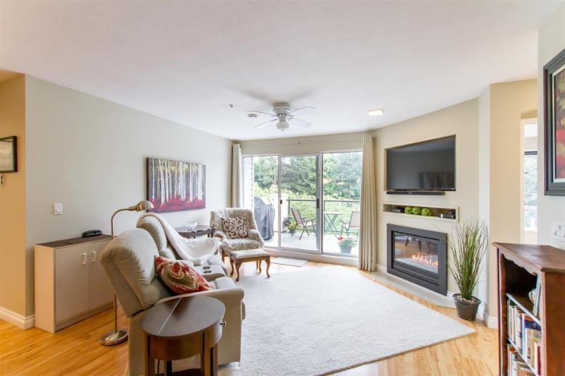 "Main Photo: 307 20976 56 Avenue in Langley: Langley City Condo for sale in ""Riverwalk"" : MLS®# R2464309"