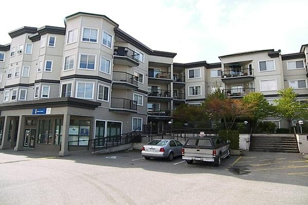"Main Photo: 5759 GLOVER Road in Langley: Langley City Condo for sale in ""COLLEGE COURT"" : MLS®# F2709459"