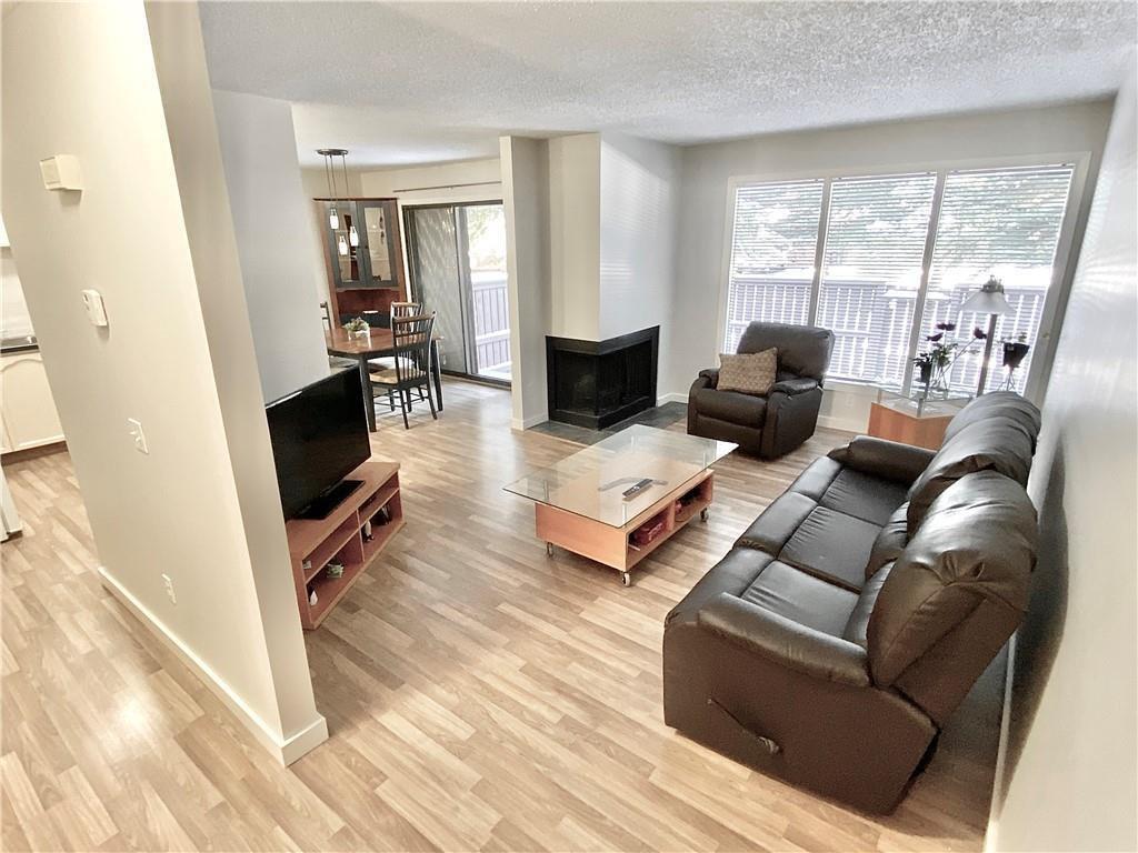 Main Photo: 48 2323 OAKMOOR Drive SW in Calgary: Palliser Row/Townhouse for sale : MLS®# C4272425