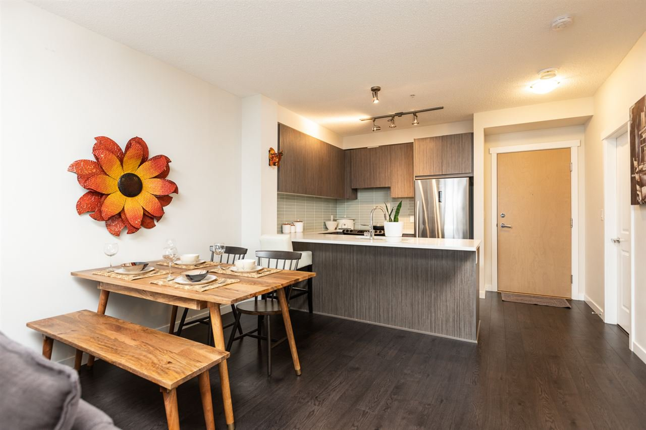 Main Photo: 409 9168 SLOPES Mews in Burnaby: Simon Fraser Univer. Condo for sale (Burnaby North)  : MLS®# R2412186