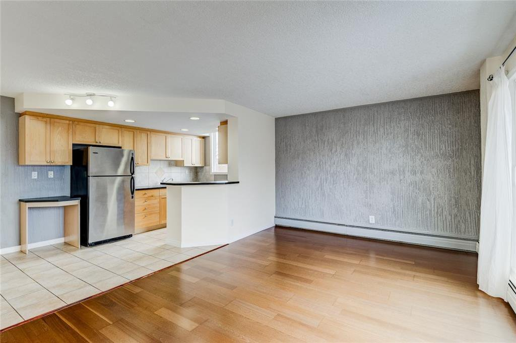 Main Photo: 401 340 4 Avenue NE in Calgary: Crescent Heights Apartment for sale : MLS®# C4290913