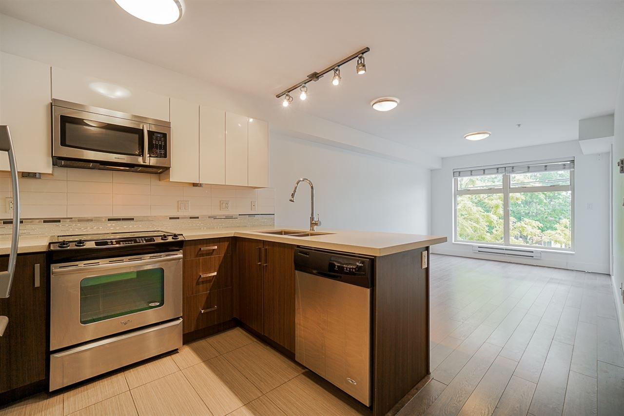 "Main Photo: 206 2408 E BROADWAY in Vancouver: Renfrew Heights Condo for sale in ""BROADWAY CROSSING"" (Vancouver East)  : MLS®# R2459022"
