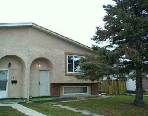 Main Photo: 745 SHEPPARD Street in Winnipeg: Maples / Tyndall Park Single Family Attached for sale (North West Winnipeg)  : MLS®# 2704534