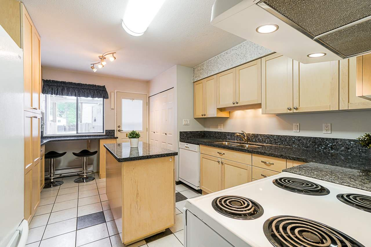"""Photo 3: Photos: 69 8555 KING GEORGE Boulevard in Surrey: Queen Mary Park Surrey Townhouse for sale in """"BEAR CREEK VILLAGE"""" : MLS®# R2397033"""