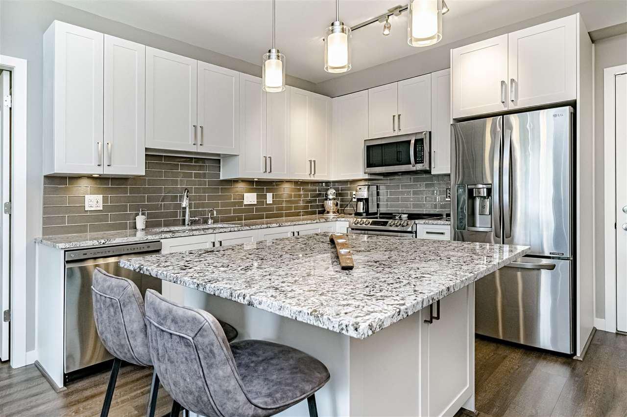 "Main Photo: 117 6490 194 Street in Surrey: Clayton Condo for sale in ""WATERSTONE - ESPLANADE"" (Cloverdale)  : MLS®# R2404179"