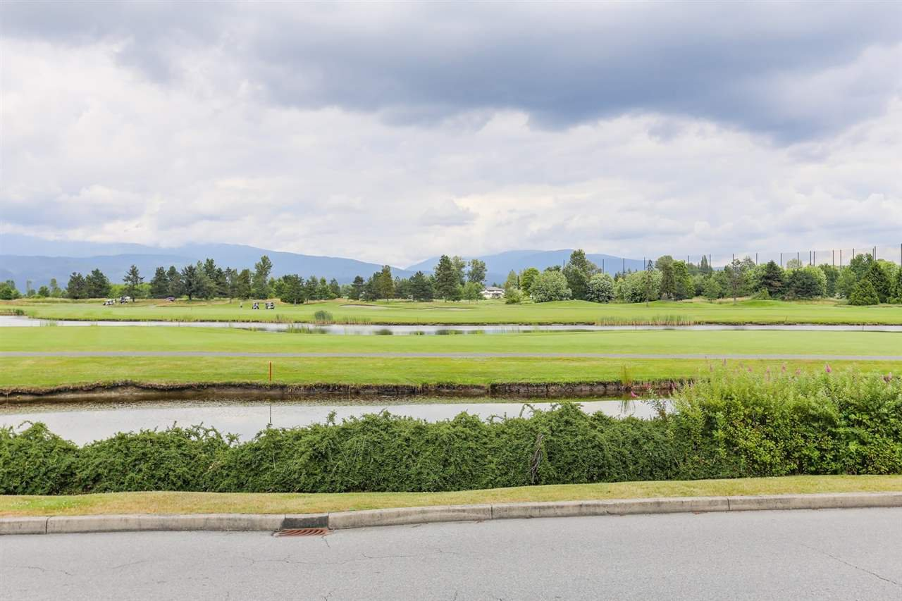 "Main Photo: 416 19677 MEADOW GARDENS Way in Pitt Meadows: North Meadows PI Condo for sale in ""THE FAIRWAYS"" : MLS®# R2410673"