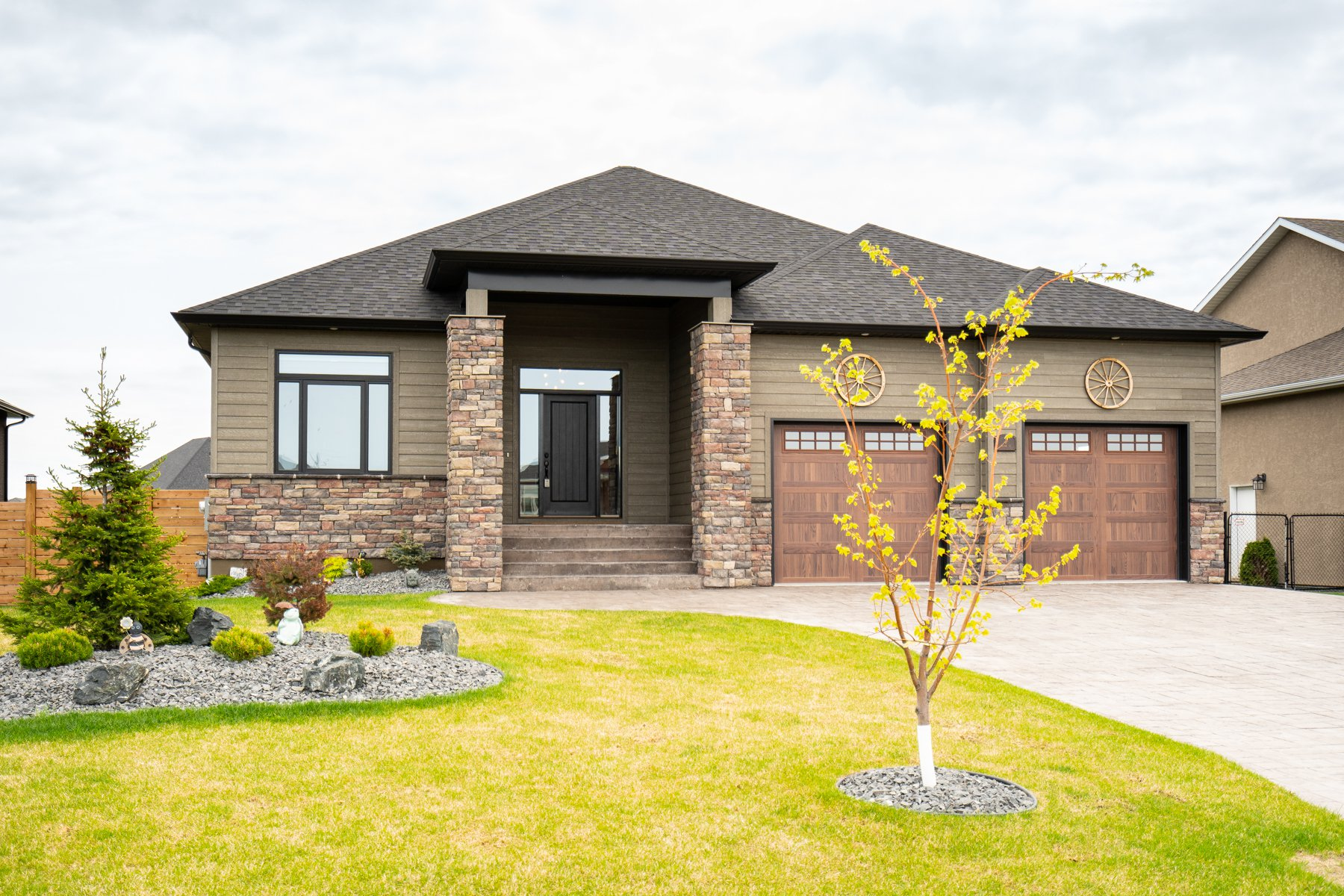 IMMACULATE 1938 SF 3 Bedroom Bungalow (2018), fully finished walk-out basement on beautifully landscaped fenced lake lot in Town of Oakbank.
