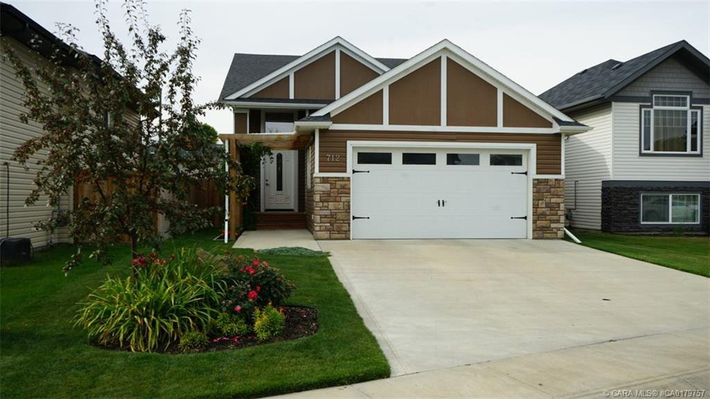Photo 1: Photos: 712 CYPRESS Lane in Springbrook: RC Springbrook Residential for sale (Red Deer County)  : MLS®# CA0179757