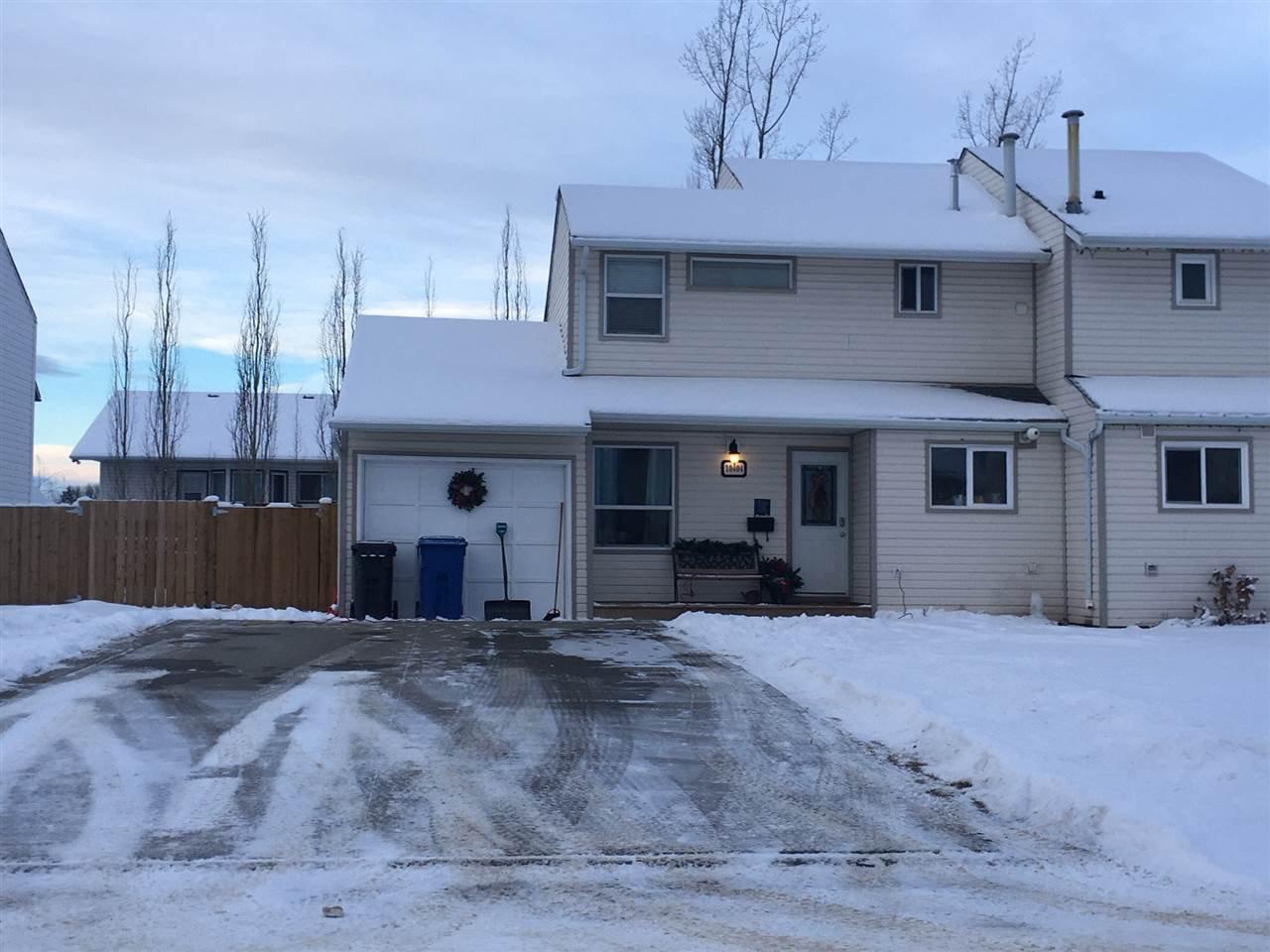 Main Photo: 10404 88A Street in Fort St. John: Fort St. John - City NE House 1/2 Duplex for sale (Fort St. John (Zone 60))  : MLS®# R2424825
