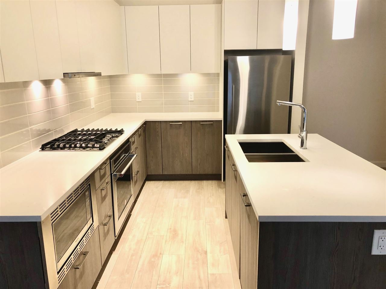 Quartz counters and quality stainless steel appliance package