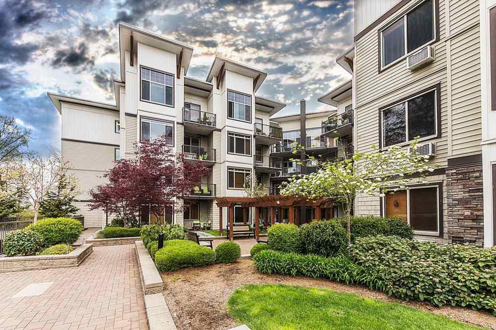 "Main Photo: 106 11887 BURNETT Street in Maple Ridge: East Central Condo for sale in ""WELLINGTON STATION"" : MLS®# R2425490"