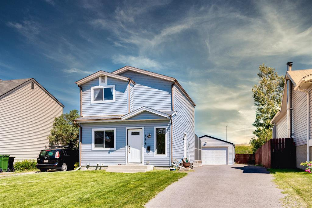 Beautiful curb appeal, well manicured lawn and paved driveway and parking.