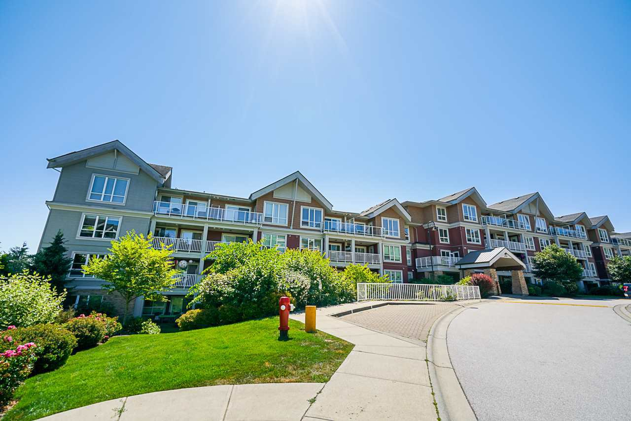 "Main Photo: 216 6440 194 Street in Surrey: Clayton Condo for sale in ""Waterstone"" (Cloverdale)  : MLS®# R2479953"