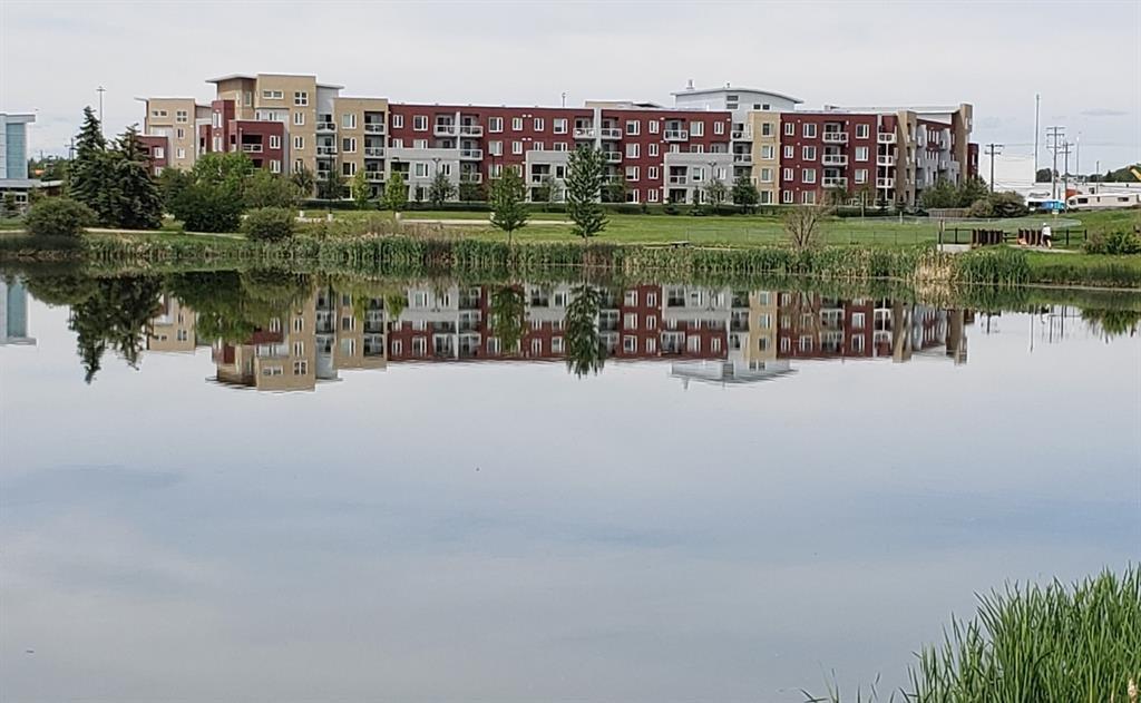 Main Photo: 2231 604 East Lake Boulevard NE: Airdrie Apartment for sale : MLS®# A1045955