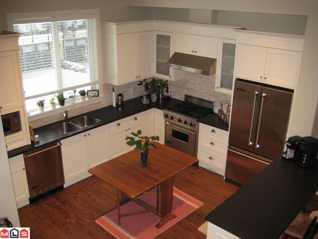 "Main Photo: 423 2580 LANGDON Street in Abbotsford: Abbotsford West Townhouse for sale in ""THE BROWNSTONES ON THE PARK"""