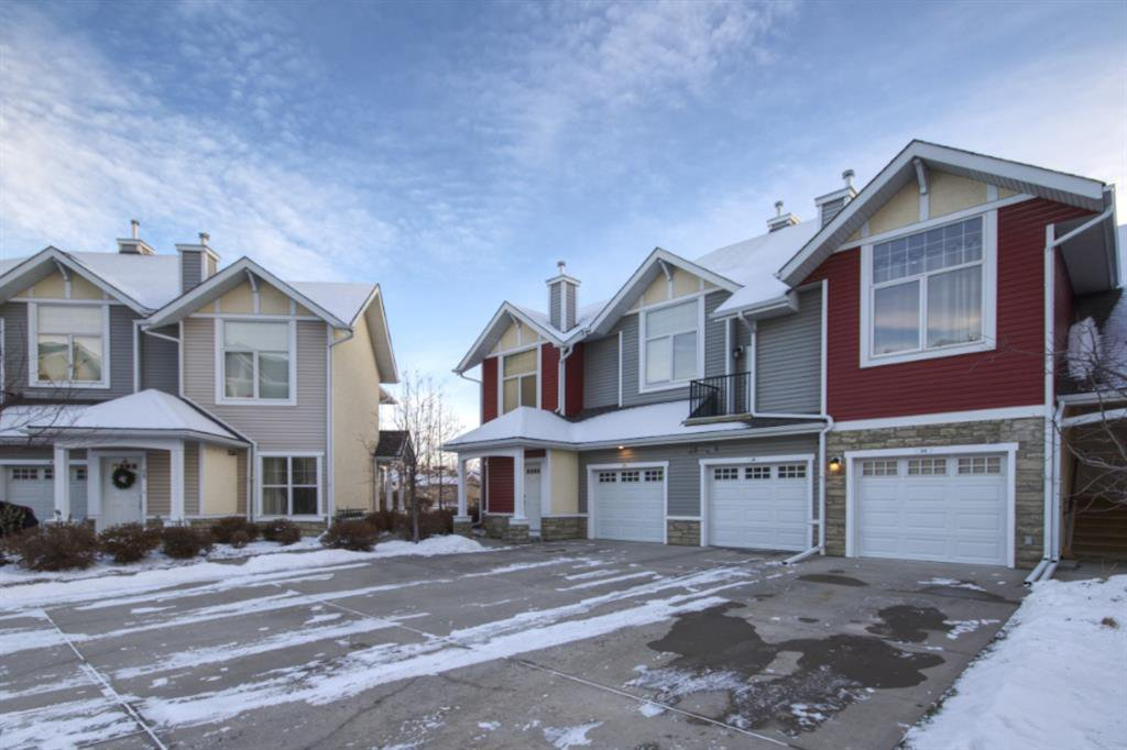Main Photo: 24 WEST SPRINGS Lane SW in Calgary: West Springs Row/Townhouse for sale : MLS®# A1050646