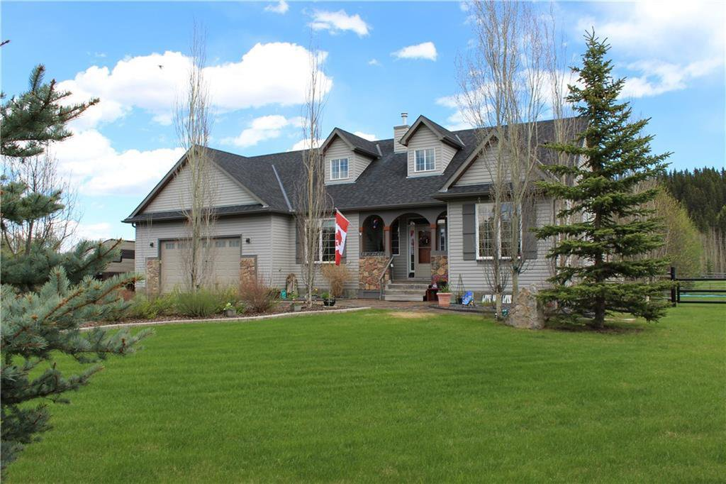 This beautiful acreage is only 15 minutes to Calgary!
