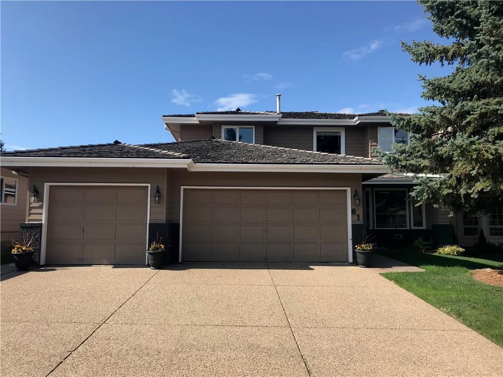 Main Photo: 61 Suncastle Crescent, Sundance Calgary Realtor Steven Hill SOLD Luxury Home