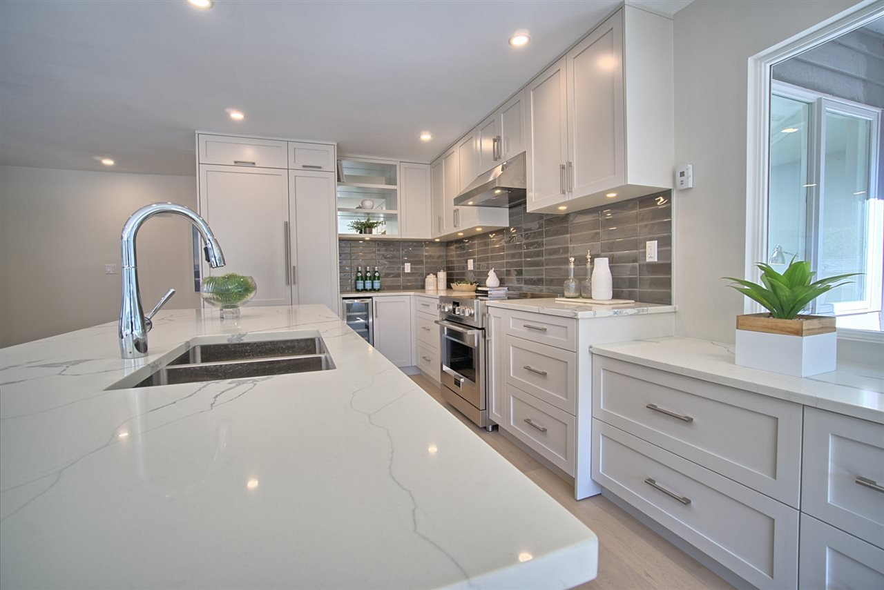 """Main Photo: 5944 NANCY GREENE Way in North Vancouver: Grouse Woods Townhouse for sale in """"Grousemont Estates"""" : MLS®# R2446359"""