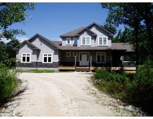 Long driveway, plenty of parking.  Stone and stucco exterior grace the front of this incredible custom designed home.