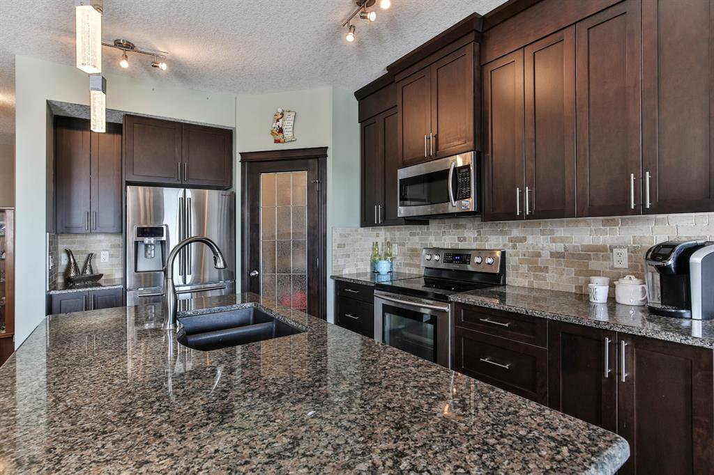 Photo 7: Photos: 86 NOLANFIELD Road NW in Calgary: Nolan Hill Detached for sale : MLS®# A1018616