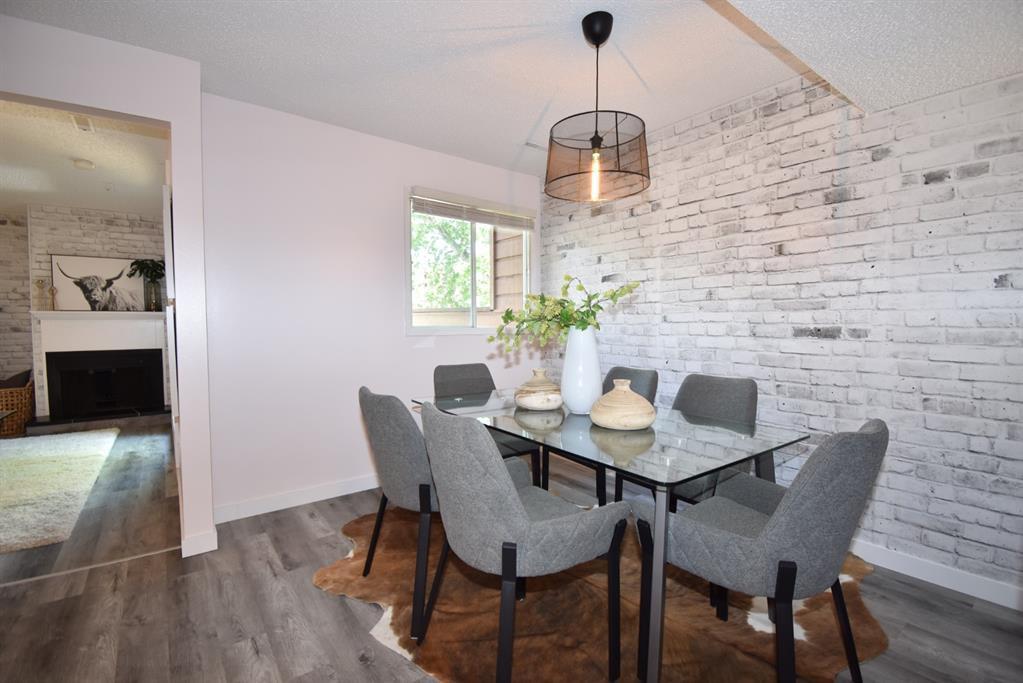 Main Photo: 112 2520 PALLISER Drive SW in Calgary: Oakridge Row/Townhouse for sale : MLS®# A1012336
