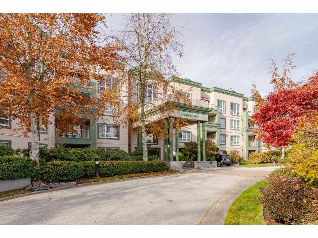 "Main Photo: 125 13880 70 Avenue in Surrey: East Newton Condo  in ""Chelsea Gardens"" : MLS®# R2419159"