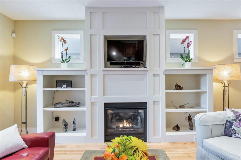 Built-in cabinets and gas fireplace make this living room cozy and relaxing.