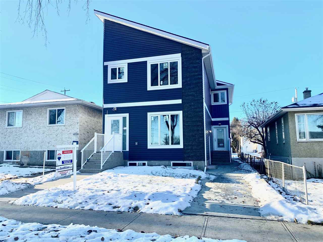 Main Photo: 11812 64 Street NW in Edmonton: Zone 06 Duplex Front and Back for sale : MLS®# E4222512