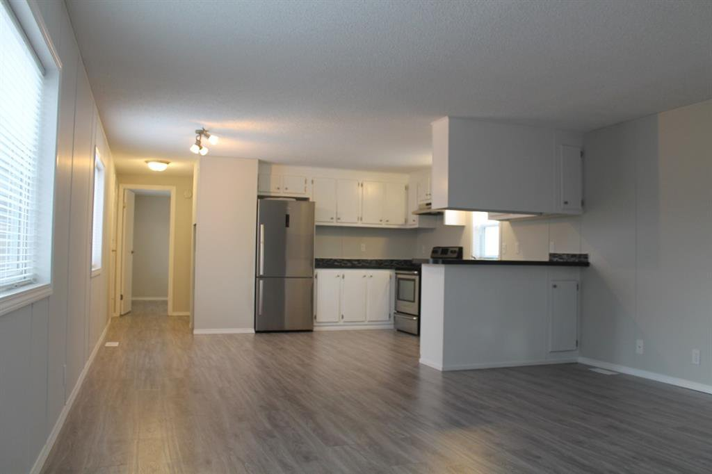 Photo 5: Photos: 75 9090 24 Street SE in Calgary: Riverbend Mobile for sale : MLS®# A1049275