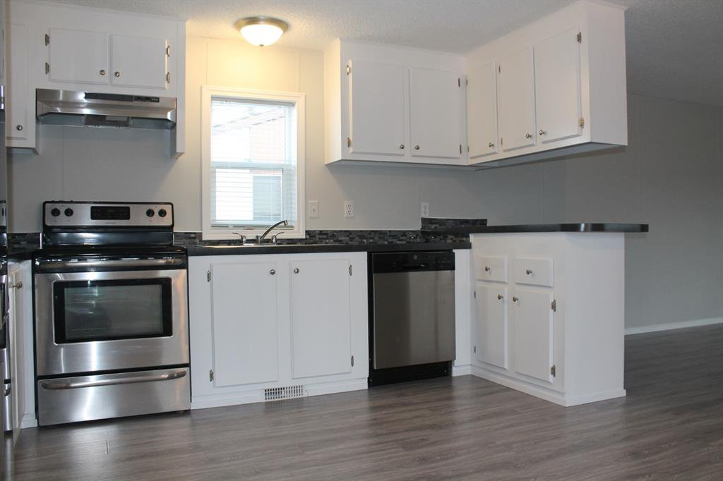 Photo 4: Photos: 75 9090 24 Street SE in Calgary: Riverbend Mobile for sale : MLS®# A1049275