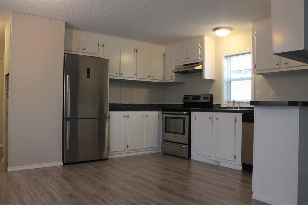 Photo 2: Photos: 75 9090 24 Street SE in Calgary: Riverbend Mobile for sale : MLS®# A1049275