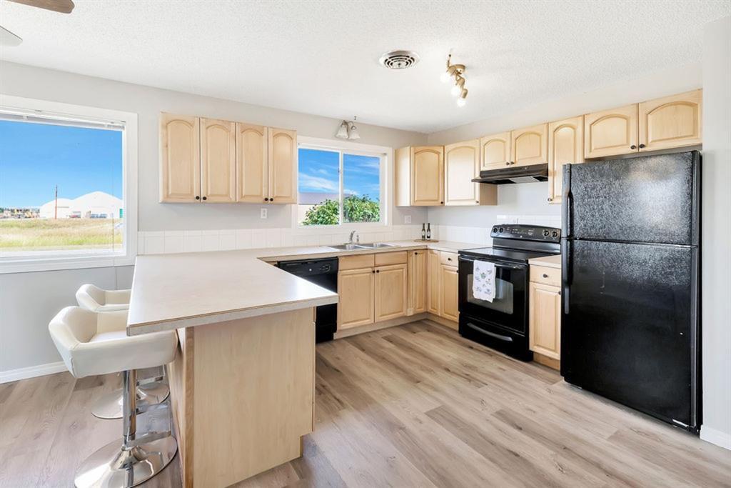 Photo 10: Photos: 105 Brooks Street: Aldersyde Detached for sale : MLS®# A1021637