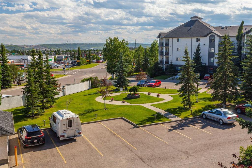 Main Photo: 407 55 ARBOUR GROVE Close NW in Calgary: Arbour Lake Apartment for sale : MLS®# A1015992