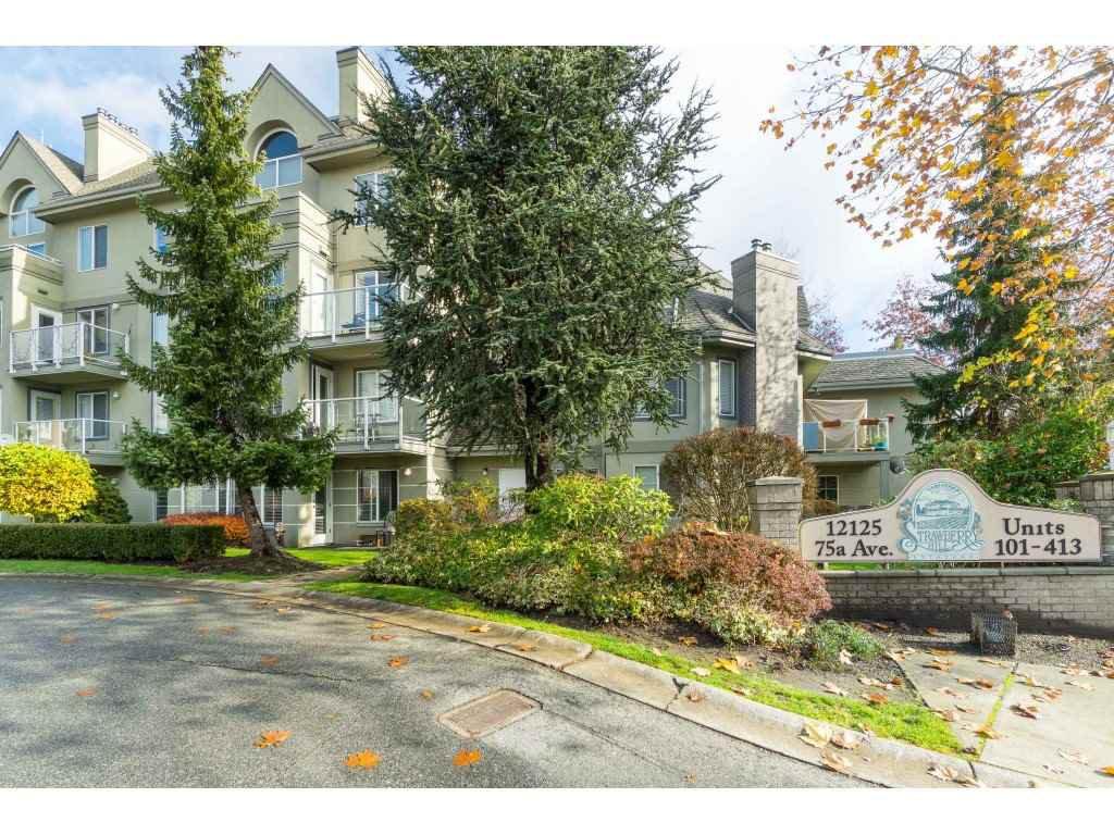 "Main Photo: 104 12125 75A Avenue in Surrey: West Newton Condo for sale in ""STRAWBERRY HILL ESTATES"" : MLS®# R2411249"