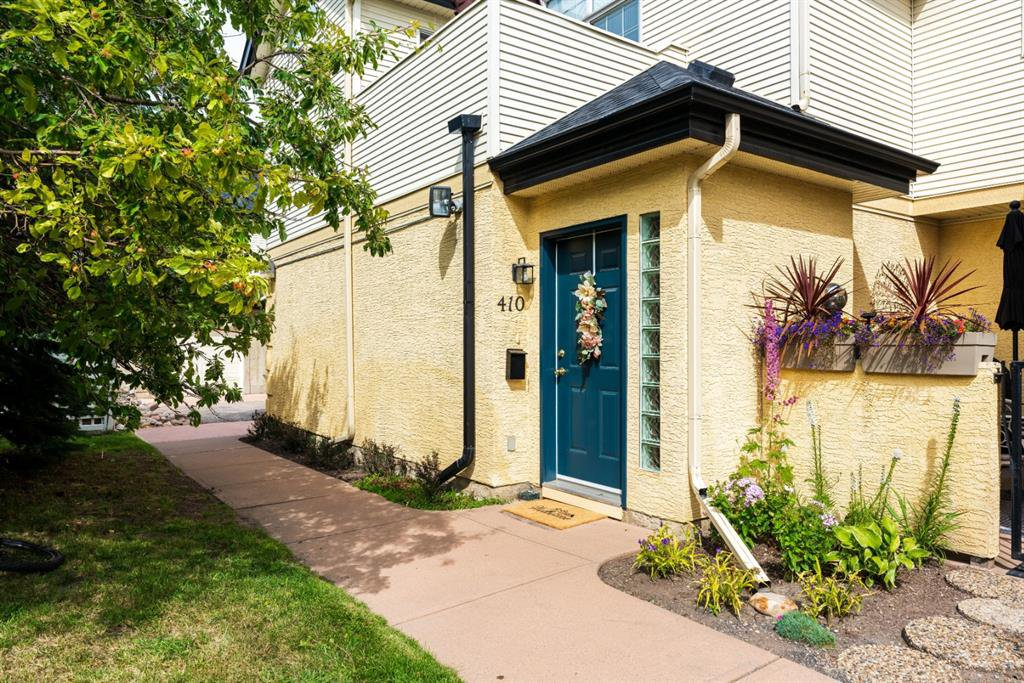 Main Photo: 410 405 32 Avenue NW in Calgary: Mount Pleasant Row/Townhouse for sale : MLS®# A1024091