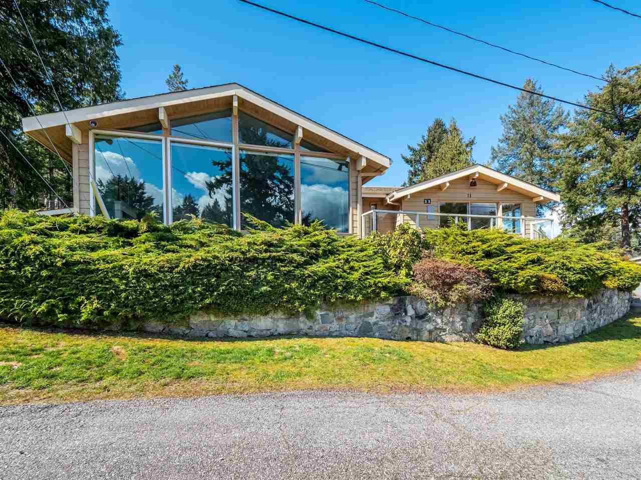 this home comes with moorage including a 22 ft boathouse!  Also, the living area is spacious for your bigger furnishings and there are numerous windows to let in plenty of light.