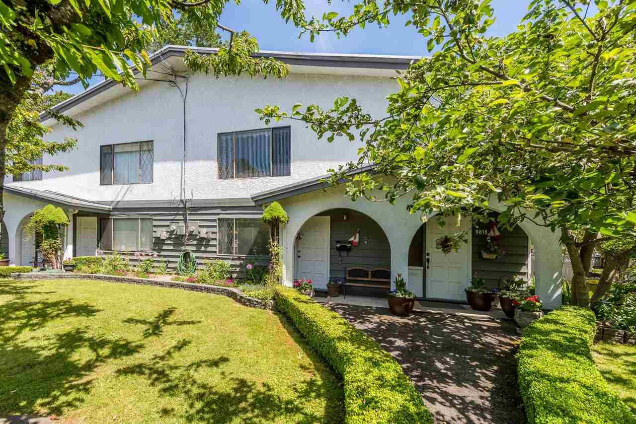 "Main Photo: 8618 154 Street in Surrey: Fleetwood Tynehead House 1/2 Duplex for sale in ""Fleetwood area"" : MLS®# R2394277"