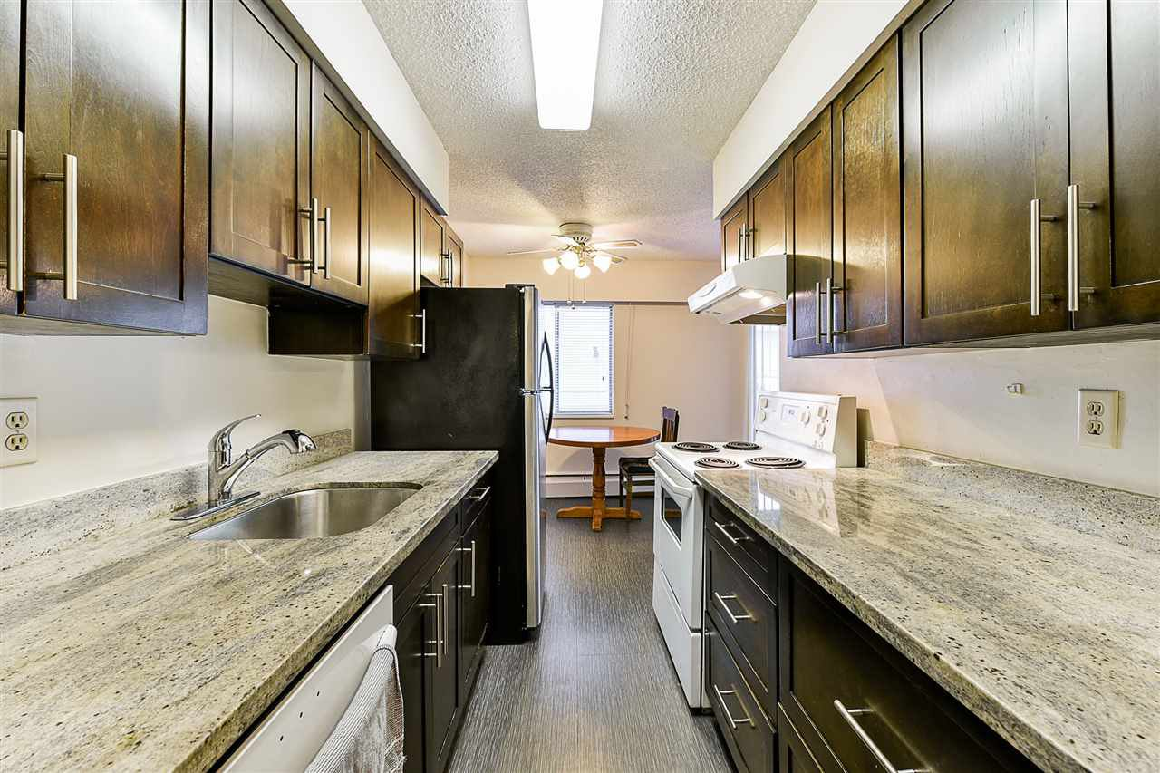 "Photo 3: Photos: 108 815 FOURTH Avenue in New Westminster: Uptown NW Condo for sale in ""NORFOLKHOUSE"" : MLS®# R2439442"