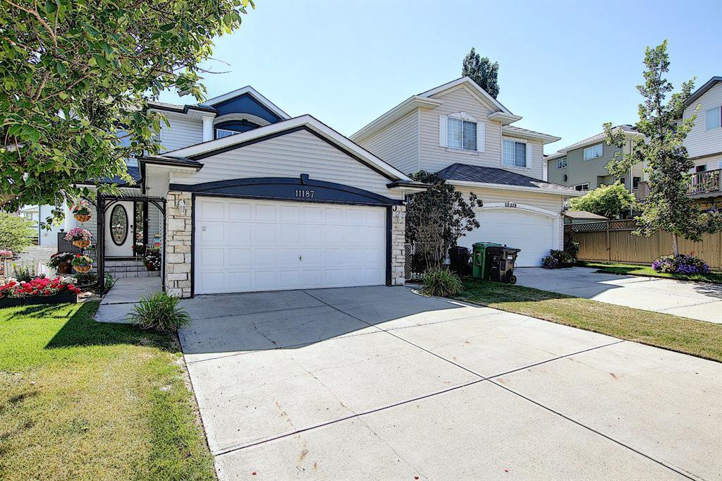 Main Photo: 11187 HIDDEN VALLEY Drive NW in Calgary: Hidden Valley Detached for sale : MLS®# A1027539