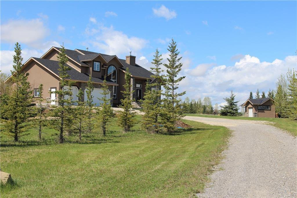 2.78 Acres with a front NE exposure: 2 Storey, 3 car over-sized, heated garage (with bathroom).  Variety of trees and shrubs, nicely landscaped, great outdoor space for entertaining, pond, fireplace and a large shed. Short drive (or walk) to Springbank sc