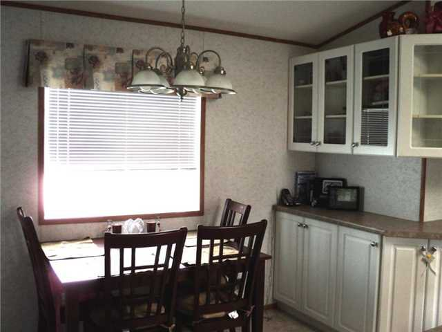 """Photo 4: Photos: 43 5701 AIRPORT Drive in Fort Nelson: Fort Nelson -Town Manufactured Home for sale in """"SOUTHRIDGE MOBILE HOME PARK"""" (Fort Nelson (Zone 64))  : MLS®# N212129"""