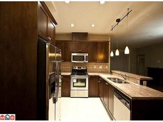 "Main Photo: 418 14333 104 Avenue in Surrey: Whalley Condo for sale in ""PARKCENTRAL"" (North Surrey)  : MLS®# R2244378"